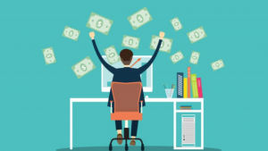 A cartoon picture of a guy sitting at a computer while dollars float on the air around him