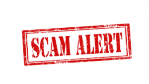 A red and white picture that reads scam alert