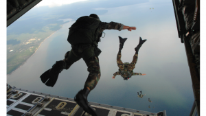 a picture of a man jumping from an airplane